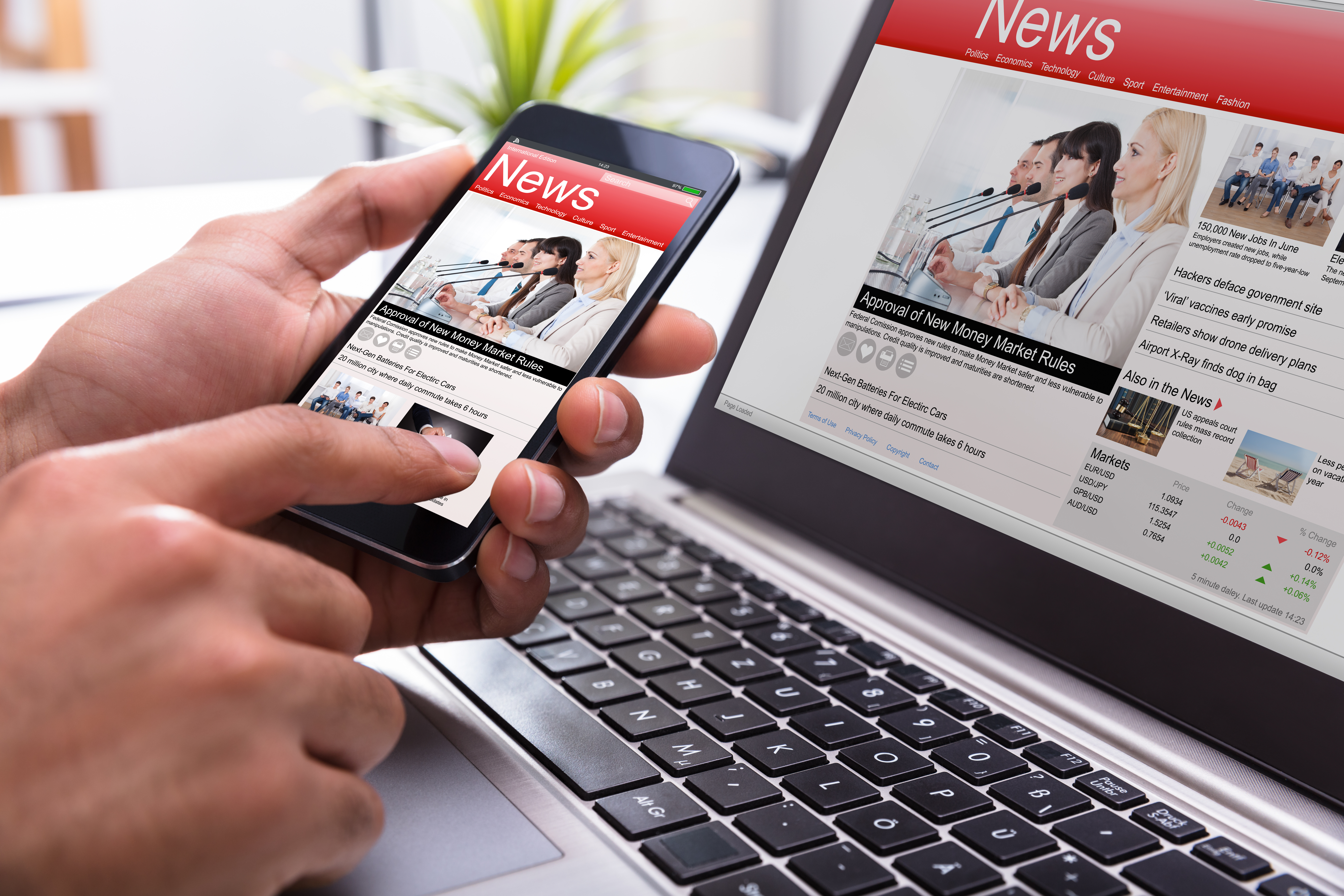 Person holding phone with online news displayed