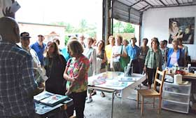crowd of people attending art tour