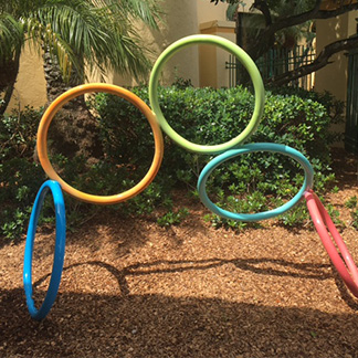 sculpture titled, friendship rings. 5 rings are joined together in an arc formation.