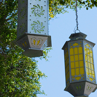 artwork, suspended from tree branches, titled, three lanterns