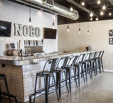 picture of bar stools lined up inside nobo brewery