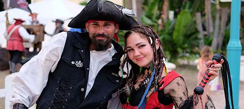 Two people in pirate costumes.