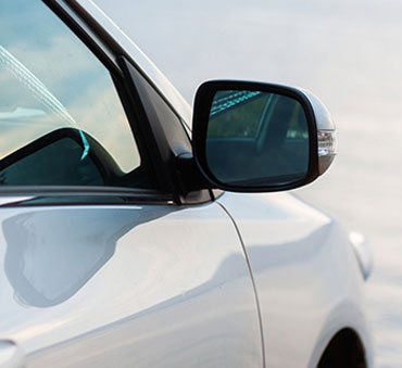 car's side view mirror and passenger window