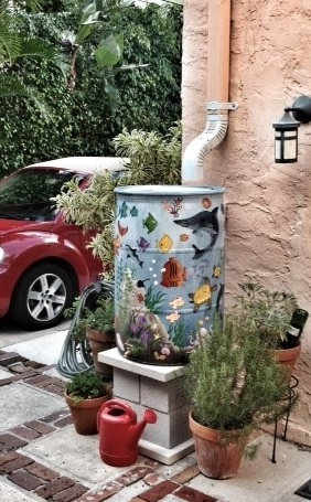 Rain barrel with exterior decorated by underwater scene