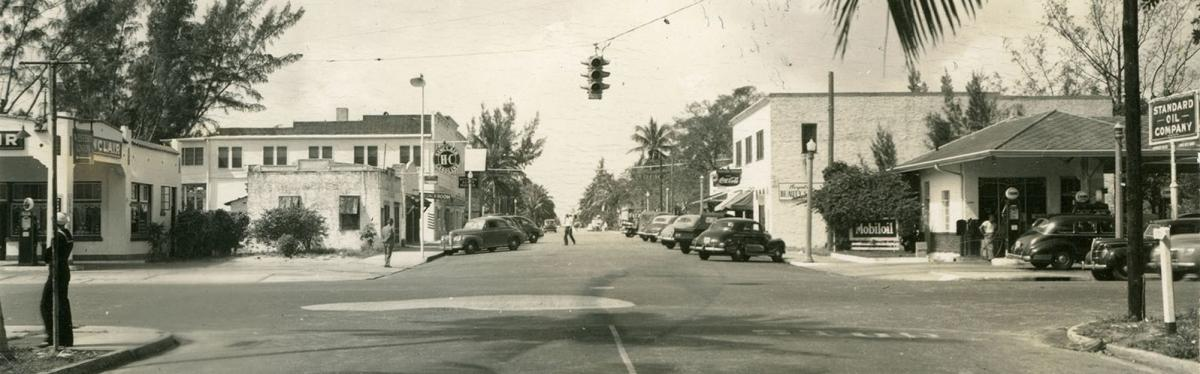 Street intersection with traffic signal (circa 1950s)
