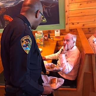 police serving a restaurant patron