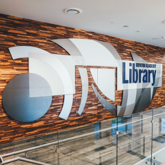 Image of the exterior mural near the main entrance of the adult library