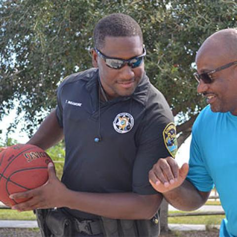 police and recreation men playing basketball