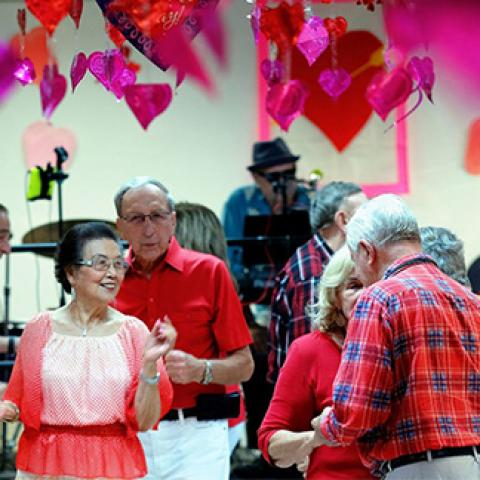 senior citizens at valentines day party