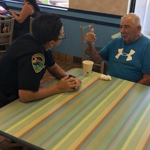 cop with civilian drinking coffee
