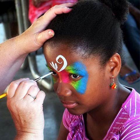 girl having her faced painted