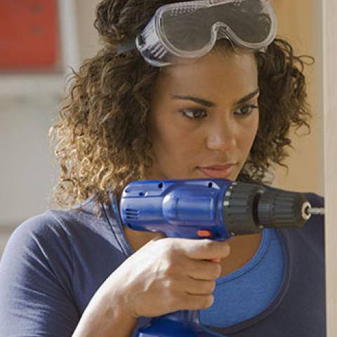 women with a drill