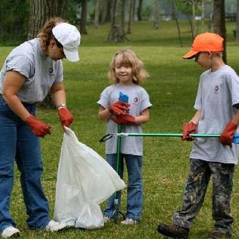 park cleanup kids helping adult clean