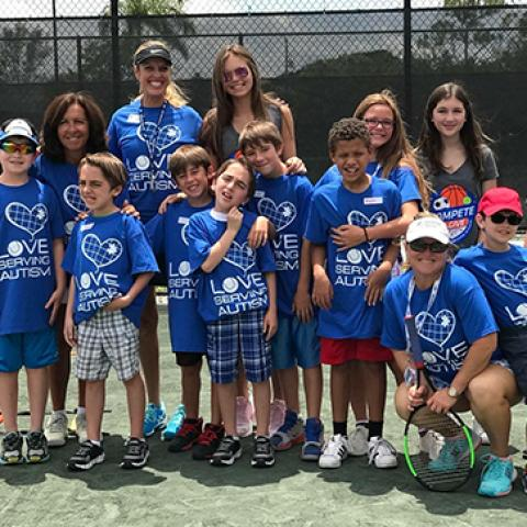 love serving autism group of children in program on tennis court