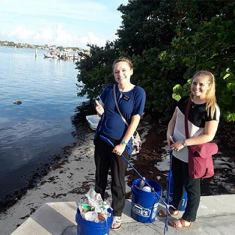 girls cleaning up intracoastal